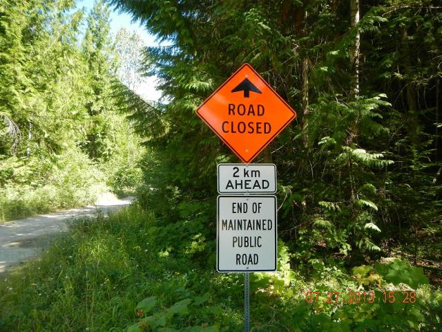 The signage clearly marks Lemon Creek Road as an inactive road. Photo courtesy Ministry FLNRO